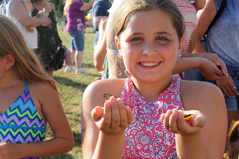 Teen Holding Butterflies
